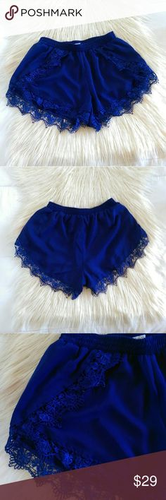 TOBI Floral Crochet Trim Shorts in Royal Blue Super cute lace crochet trim shorts in rich royal blue color by TOBI. Soft and silky material, can dress up, wear casually, or for lounging. Elastic waist to adjust fit. Waist measures 12' flat across. Length is 13'.   Excellent condition.  Open to offers. No trades. No modeling. Tobi Shorts