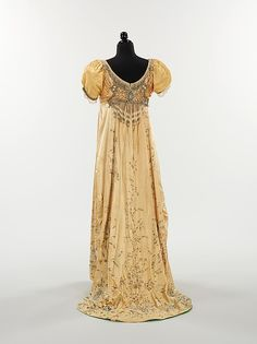 Embroidered pale yellow silk evening dress with rhinestone decoration (back), by Mme. Besancon de Wagner for House of Drécoll, French, 1910.