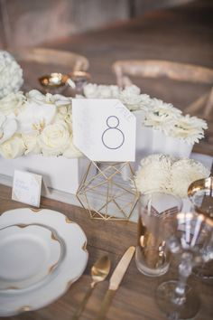 I like the gold geometric centerpiece. Love open modern geometric shapes, and gold.