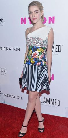 Kiernan Shipka put together an impeccable summer-ready outfit, hitting the red carpet in a one-shoulder mixed-print floral Dior number that she styled with an Edie Parker clutch and black strappy mules.