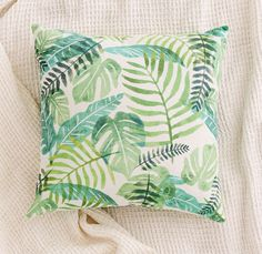 Bring a little bit of nature into your space with this printed palm pillow.