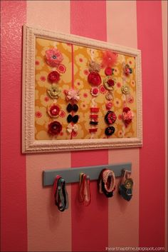 I like the idea of displaying the girls' hair bows as a way to organize them.