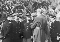 """From left, front row: Adm. Darlan, Adm. Sir Andrew Browne Cunningham, General Eisenhower, and Henri Giraud with back turned.Darlan shut down armed resistance and took Vichy North Africa over to the Allies' side. (He had, indeed, hinted previously to American diplomats that he was prepared to switch sides; see Arthur Funk, """"Negotiating the 'Deal with Darlan'"""" in Journal of Contemporary History, April 1973.) In exchange, the Allies installed him as High Commissioner of France for North and…"""