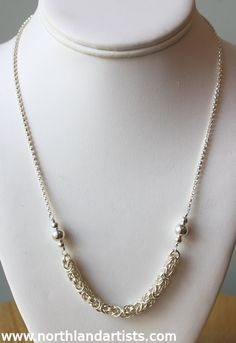 A handmade sterling silver necklace by jewelry artist Susan Pauls with a Byzantine weave chainmaille section, available at Northland Exposure Artists' Gallery, #Parkville, MO. #art #handmade #jewelry #necklace #chainmaille