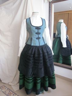 Regional dress from Galicia, in northwestern Spain. Click through for close-ups of the hand smocking and other details