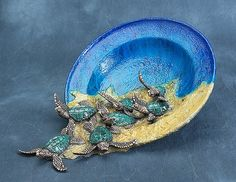 """Bronze sea turtle vessel titled """"The Roots of Heaven"""", created and sculpted entirely in wax by artist Joseph Quillan. Cast in bronze and completely finished from beginning to end in the U.S. Roots of Heaven shows seven sea turtle babies scrambling so fast towards the sea that they turn over their dish and escape."""