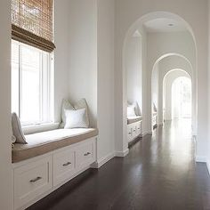 Stocker Hoesterey Montenegro - entrances/foyers - archway, arched doorway, row of arches, row of arched in hallway, hallway arches, hardwood...
