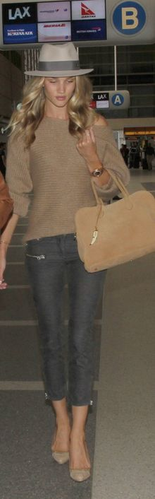 Who made Rosie Huntington-Whiteley's jewelry, nude pumps, skinny pants, suede handbag, hat, and beige sweater that she wore at LAX airport?