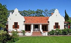 Traditional #CapeDutch style home in South Africa.  Front porch has a roof vs. open trellis.  Beautiful twin gables..
