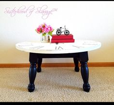 """Beautifully upcycled in a Paris theme, this unique Coffee Table is constructed of solid wood. Hand stencil work and chalk painted in linen white and the base in ink black; lightly distressed for a vintage look. Hand rubbed with clear wax to seal. Measures 31&1/2"""" Diameter 16"""" tall. Credit cards accepted and delivery is available.  Purchase online at https://www.rachelsrefinds.com/product-page/paris-coffee-table  Artist: Sisterhood of Salvage, Windsor CO"""