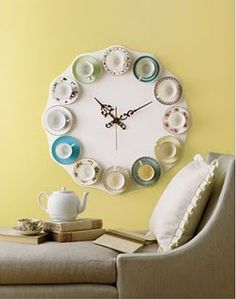 Tea cup clock - Umbra (easily DIY)    Oh, this is so very me.  I'd like to find some miniture tea cups to make it with, I certainly won't use my collection of my Grandma's teacups!