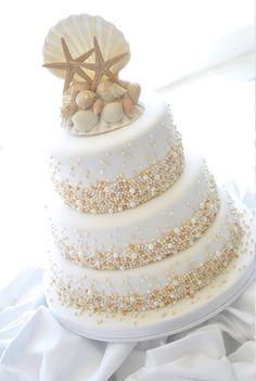 Beach wedding cake. Amazing, love the pearls on each tier