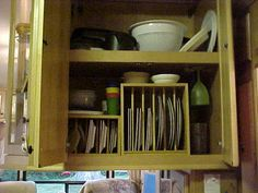 RV kitchen cabinets - upright storage for plates, then use Kitchen Corrals for mugs.