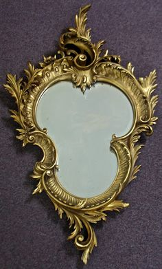We just finished work on this gorgeous mirror frame.  There were pieces actually missing!