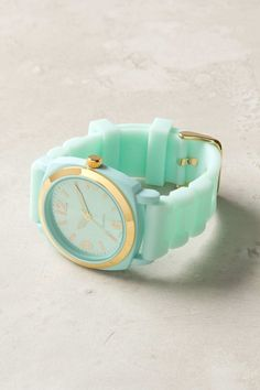 Mint and gold watch.