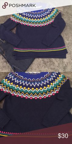Sweater Winter sweater. Breathtaking colors bounce off this navy blue sweater. Sweaters