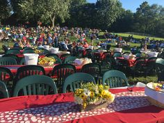 2017   Our red tablecloths make it easy to spot our tables at the event. We loved the centerpieces and table runners for this year's lawn tables, too.