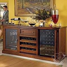Wine Enthusiast Siena Walnut Wood Wine Credenza with Touchscreen Wine Fridge, 28 Bottle Tulip and Walnut hardwoods Hand crafted and sanded Accented with solid brass hardware One spacious storage area with sliding glass door Three rolling wood shelves Wine Refrigerator, Wine Fridge, Siena, Wine Credenza, Sideboard, Wine Buffet, Wine Hutch, Muebles Living, Wine Cabinets
