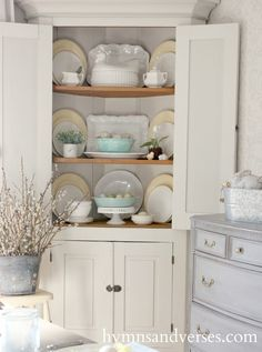 Antique corner cabinet styled for Spring and Easter with pale shades of aqua, yellow, and white. Antique Corner Cabinet, Corner Hutch, Corner Cupboard, Corner Bar, Corner Cabinets, Cupboards, China Cabinet Display, Cabinet Decor, Painted Furniture