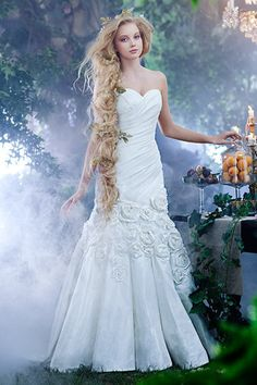 A woman wearing the Rapunzel wedding gown from the Alfred Angelo Bridal Collection Disney Inspired Wedding Dresses, Princess Wedding Dresses, Wedding Dress Styles, Disney Weddings, Wedding Disney, Princess Gowns, Robes Disney, Bridal Gowns, Wedding Gowns