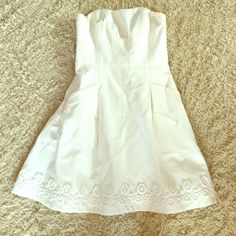 White strapless Lilly dress White strapless dress with detail at the end. Fits just like a size 00 should. Perfect condition, worn once! Unfortunately doesn't fit me anymore Lilly Pulitzer Dresses Mini