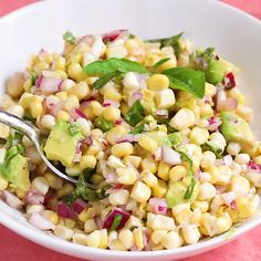 This avocado corn salad topped with lime juice and fresh basil. This salad is the perfect healthy summer side dish because there's no cooking involved!