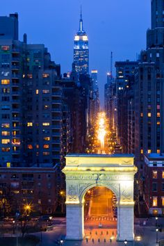 Washington Square Arch on Fifth Avenue with Empire State Building in background, New York City