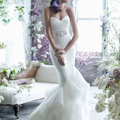 Mermaid wedding dress. I would like it if the belt/ design started just under the breasts instead though.