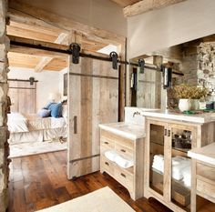 Small Bathroom Rustic Styles Design Ideas using Wood Panels Sliding Doors with Iron Railing also Large Wall Length Frameless Mirror