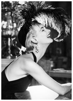 Sunny Harnett, dress by Traina-Norell, hat by Walter Florell, photo by Avedon, Paris, July 1951