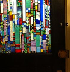 Glass on glass mosaic on antique door (mosaic by Jaymee Laws)