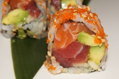 Hawaii Roll: tuna, salmon, avocado and macadamia nuts inside and sesame seeds on the outside