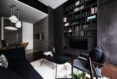 """The dark tones and innovative storage spaces transform this apartment into a functional bachelor pad with minimal renovation works required. Who: A bachelor Home: A one-bedroom condominium unit on Seletar Road When Chris Chen collected the keys to this one-bedroom apartment located in what he refers to as his """"childhood playground"""", he was very clear as to the extent of renovation that he would carry out."""