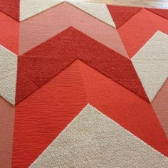 carpet tiles of different piles in chevron-like pattern and textures