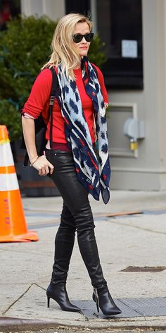 Reese Witherspoon goes for an edgy look in a printed scarf, leather pants and black pointy-toe boots