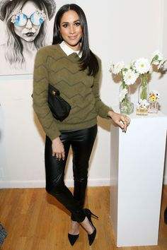 At the Marc Jacobs Daisy Chain Pop Up Shop Party, Markle wore leather-look trousers and a green jumper.