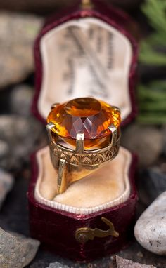 This incredible vintage citrine cocktail ring features an amazing mesmerizing round cut citrine with yellow and red colors that mixes to create a brilliant orange. The setting is crafted of gold and we left it unpolished with its natural aged patina. Book Jewelry, Cute Jewelry, Jewelry Bracelets, Jewellery, Gothic Girls, Gothic Lolita, Pink Sapphire, Yellow Diamonds, Steampunk Fashion