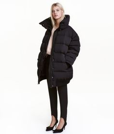 Black. PREMIUM QUALITY. Oversized down jacket in woven fabric with a detachable stand-up collar with press-studs and a zip and wind flap with press-studs at