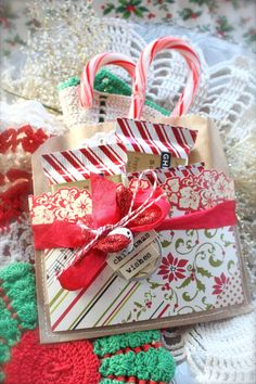 """How to make a double pocket gift bag. This idea will work for any season or occasion. Make a fold in a brown paper sack and stitch on 3 sides; now you have a bag with 2 pockets. Blogger calls them """"Double Pocket Pretties"""". Mish Mash: 12 Days of Christmas...Day 3."""