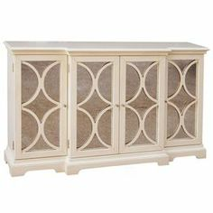 """Reminiscent of Old Hollywood style, this weathered credenza features 4 doors with lattice overlay opening to 3 adjustable shelves.    Product: Credenza   Construction Material:  Wood and mirrored glass   Color:  Cream   Features:  Three adjustable shelves  Four doors                 Dimensions:  37"""" H x 60"""" W x 14"""" D"""