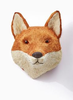 This fox head that is made of straw, is great for a 'woodland Christmas' decor or window display theme, or as part of the decor for your holiday party. A simple hook on the back allows you to hang the fox on the wall.
