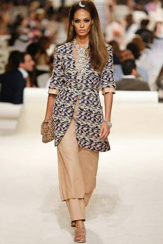 Chanel | Cruise/Resort 2015 Collection via Karl Lagerfeld | Modeled by Joan Smalls | May 13, 2014; Dubai | Style.com