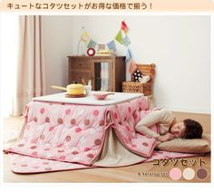 The Japanese are brilliant...they know that even a table can be a warm cozy, snuggly place to be (kotatsu table set).