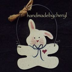 Easter Bunny Ornament Peg Hanger Wired Wood Primitive Decor Country Folk Art. $3.50, via Etsy.