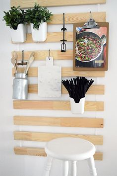 This IKEA hack has to be one of the smartest kitchen storage DIYs we've ever seen. Kristina of the blog Ich Designer hung $10 SULTAN LADE bed slats on a kitchen wall, and used s-hooks to suspend serving boards, a recipe clipboard, and a pail of utensils.
