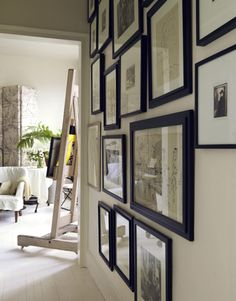 "Ellen O'Neill clustered black-and-white photos and sketches on one wall: ""It makes the hallway feel like a 'place' and not just a thoroughfare."""