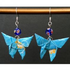Origami butterfly w/ glass bead earrings by Zewei Willa O'Connor.  To learn how to fold the origami butterfly, find the video tutorial by Ignacio Smith on my website's link page: http://www.zeweioconnor.com/links/