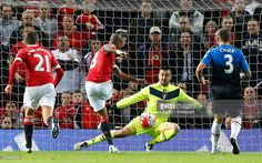 Bournemouth's Australian goalkeeper Adam Federici (C) fails to save a shot from Manchester United's English midfielder Ashley Young (2L) leading to the team's thrid goal during the rescheduled English Premier League football match between Manchester United and Bournemouth at Old Trafford in Manchester, north west England, on May 17, 2016. The match, originally scheduled for May 15, was called-off minutes before kick-off following the discovery of a suspect device, which turned out to be a…