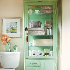 Organize with Vintage Pieces    If built-ins aren't possible, add storage and style with an antique cabinet. This homeowner stores towels and toiletries in a green vintage dental cabinet.