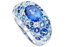 Sandrine Tessier Icy Ring Stunning blue natural sapphire, surrounding by diamonds, sapphires and aquamarines, on white palladium gold.